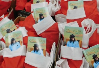 Christmas stockings with a copy of The Way to Happiness